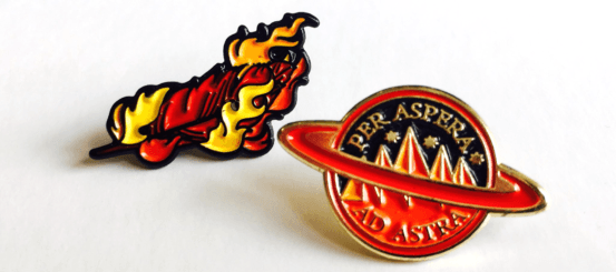 Preorder Iron Gold and get an exclusive enamel pin set!